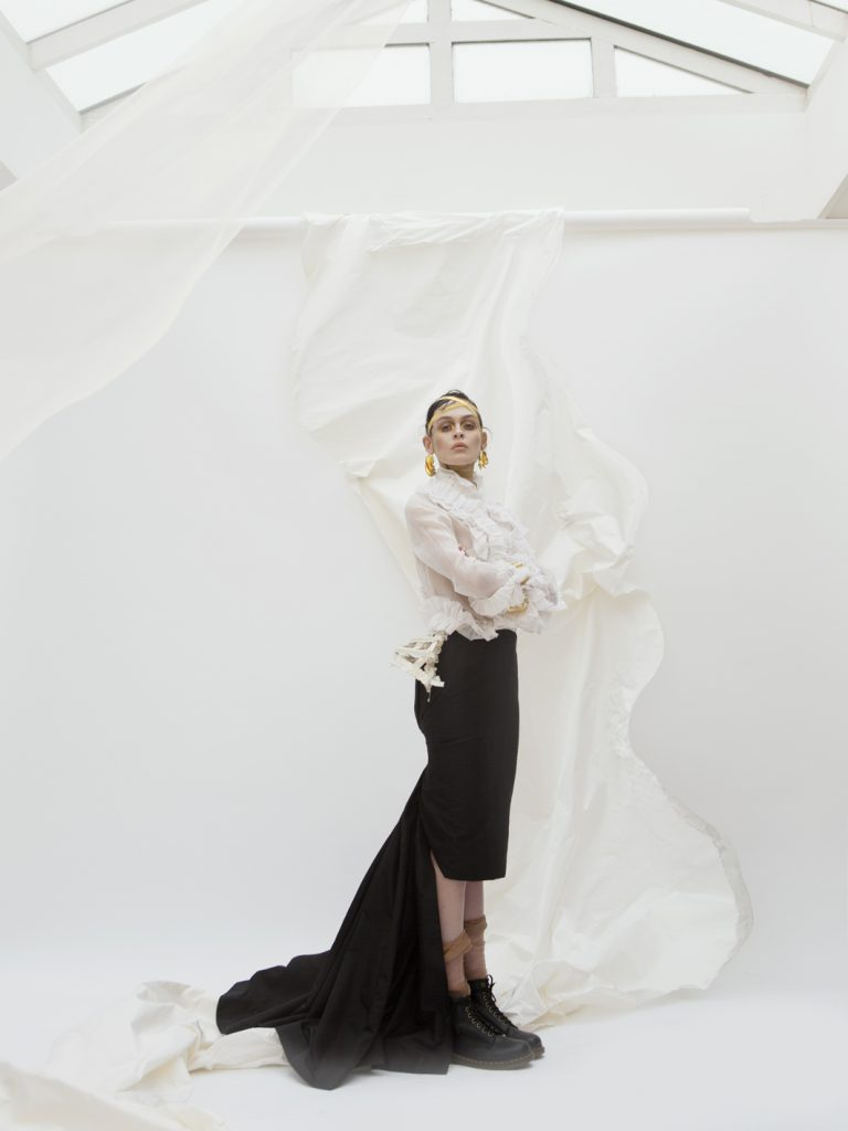 Elizabeth by Elizabeth Emanuel the Designer White cotton organdie shirt with ruffles White silk satin cage panier with ruffles and bows Slim black silk faille skirt with long pleated fishtail detail at the back