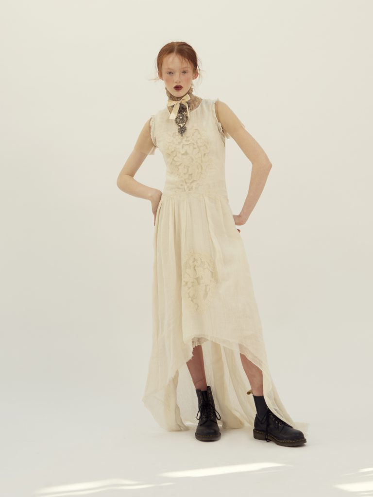Elizabeth by Elizabeth Emanuel the Designer delicate organic muslin dress with French lace decoration. New Paris 1902 silhouette . Rococo style hand made embroidered vintage crystal and pearl choker mounted on on hand dyed peach silk ribbon and tulle.