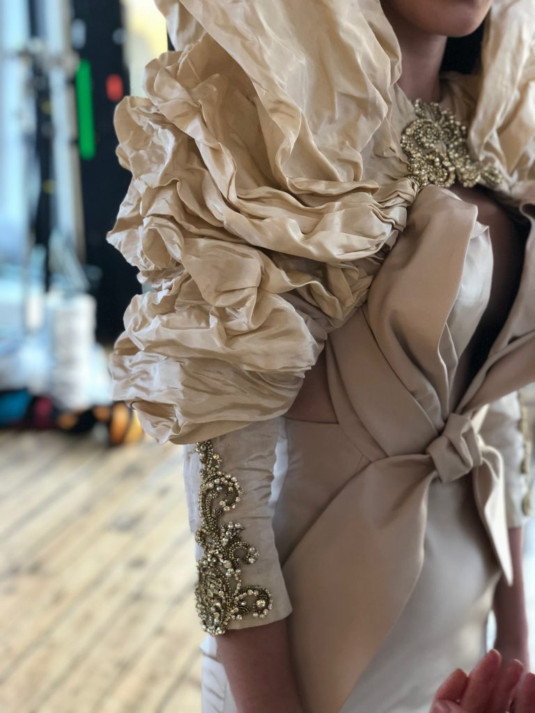 "Special Edition Red Carpet ""Bow Effect"" evening gown in palest dusty pink silk faille. Draped bust and hem. Worn with: Special Edition draped evening bolero in palest gold metallic silk taffeta with hood effect. Vintage gold crystal embroidery at the cuffs and front opening."