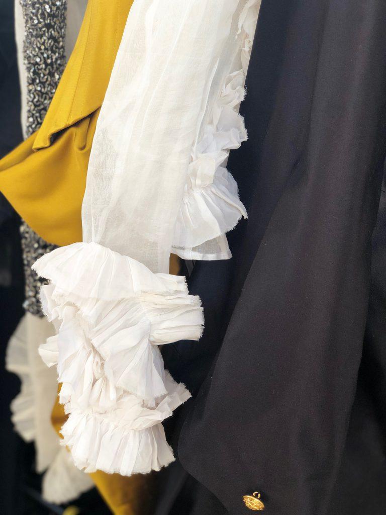 White cotton organdie shirt with ruffles.