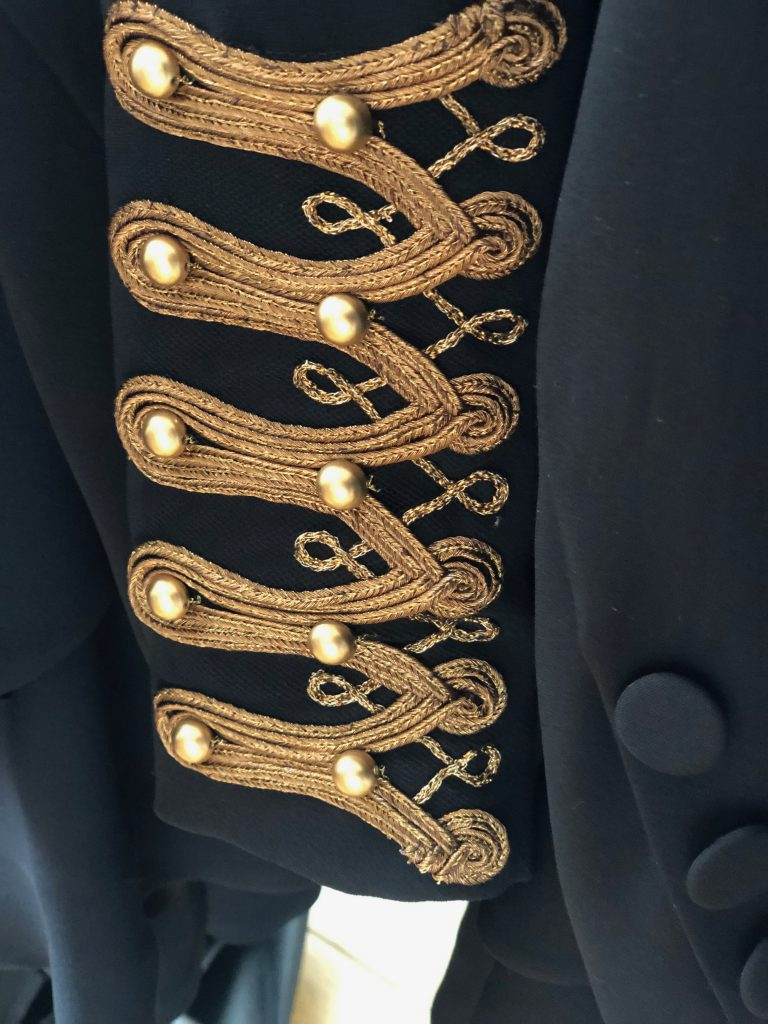 Elizabeth by Elizabeth Emanuel the Designer Red carpet Special Edition Fitted day/evening jacket in matt black silk moss crepe with military gold braid and vintage crystal applique badges. Loop details