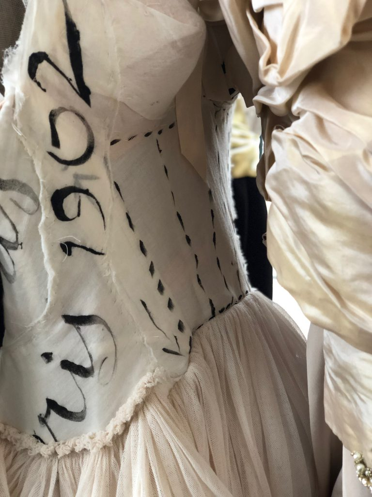 """Elizabeth by Elizabeth Emanuel the Designer Special Edition. Artisan.Hand stenciled """"Calligraphy"""" organic cotton dress with cotton tulle paniers. Boned corset bodice"""