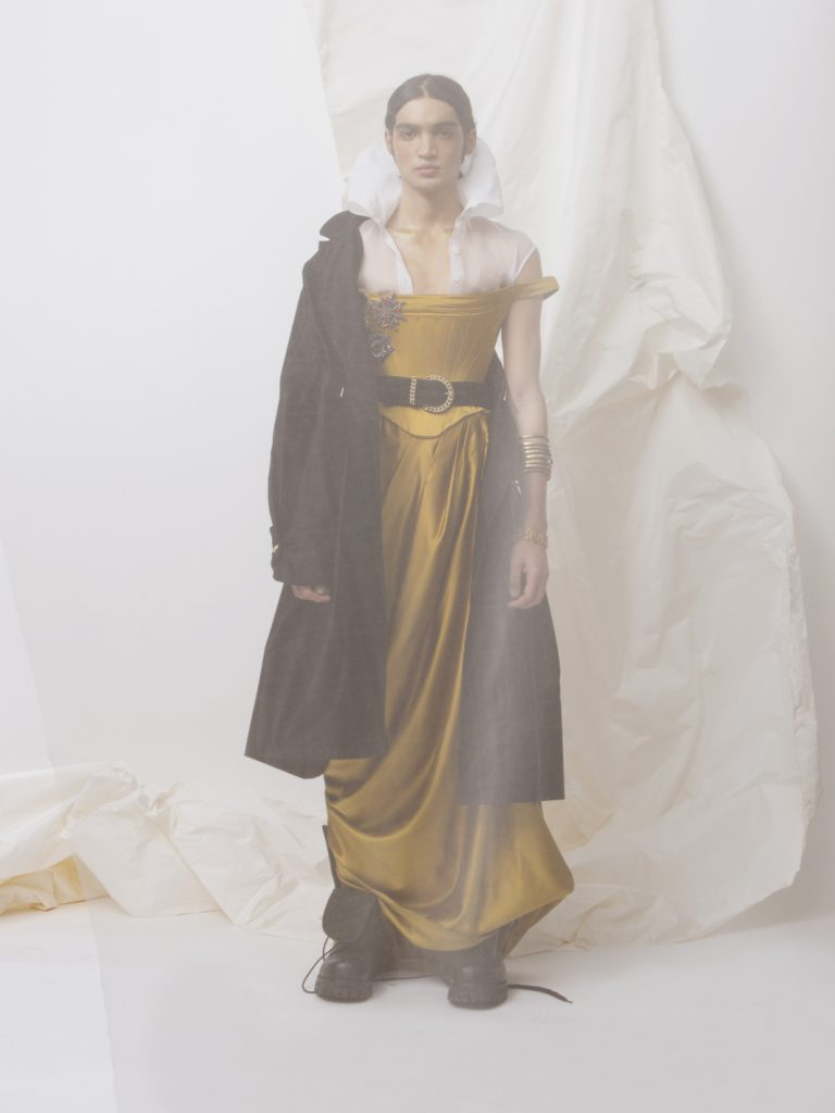 Elizabeth by Elizabeth Emanuel the Designer Androgynous Special Edition Red Carpet gold silk duchess satin corset and draped skirt. Worn with white cotton organdie corset shirt. Black silk and cotton assymmetrical satin coat with gold vintage military buttons.